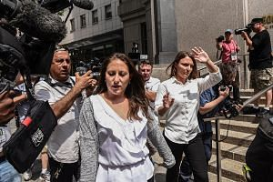 Ms Michelle Licata (left) and Ms Courtney Wild leaving the New York City courthouse last Monday after a hearing about financier Jeffery Epstein, who has been charged with sex trafficking. The two women are among those who have accused Epstein of abusing t