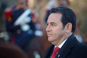 Guatemalan President Jimmy Morales was under pressure at home not to seal a deal that would oblige his country to welcome migrants in the short term.