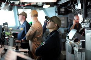 US sailors man the bridge of USS Boxer.