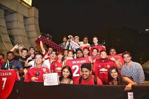 Fans waiting for the arrival of Manchester United, in town for the International Champions Cup, on July 18, 2019.