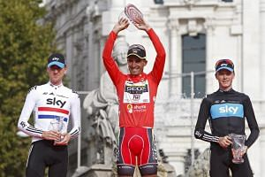 """Juan Jose Cobo (centre) was found to have """"abnormalities"""" in his biological passport between 2009 and 2011, prompting the International Cycling Union to hand him a three-year suspension, in addition to stripping his 2011 Vuelta a Espana win."""