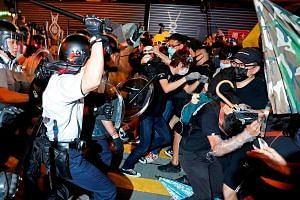 Hong Kong's riot police clashing with protesters after a march this month. A risk mitigation consulting firm says the Hong Kong government's desire to not inflame matters has had the opposite effect - prompting clashes between protesters and police,