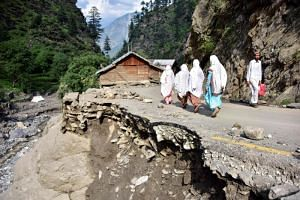 Only jagged rocks and a few damaged homes remain after torrential rains wreaked havoc on the picturesque mountain village in the Laswa Valley.