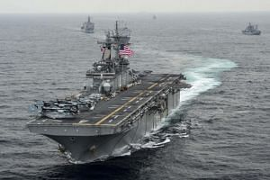 "US President Donald Trump said on July 19 the US ""immediately destroyed"" an Iranian drone that approached the USS Boxer (above) near the Strait of Hormuz, but officials in Teheran denied losing one."