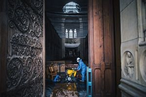 A worker inside Notre Dame cathedral in Paris on May 3, 2019.
