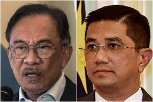 The apparent rift between Parti Keadilan Rakyat leaders Anwar Ibrahim (left) and Azmin Ali continues to dominate headlines.