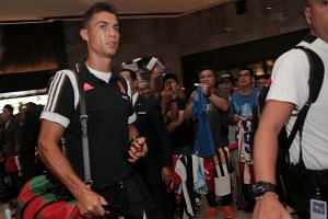 Footballer Cristiano Ronaldo arriving with Juventus at Swissotel the Stamford on July 20, 2019.