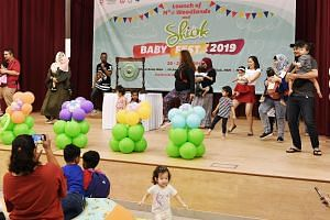 Parents and their children participating in an event at the SHIOK Baby Fest, part of the M³@Town programme, at Woodlands Galaxy Community Club on July 21, 2019.