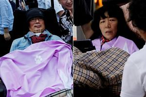 Yasuhiko Funago (left) and Eiko Kimura, severely disabled candidates won seats in Japan's upper house vote.