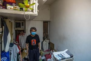 Kenneth Leung in his home in Hong Kong's Sham Shui Po district on July 12, 2019. Some such illegally subdivided apartments are so small they are called cages and coffins.