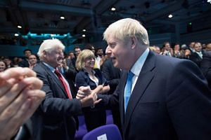 Mr Boris Johnson with his father Stanley after he was announced as the new Conservative party leader at the Queen Elizabeth II Centre in London on July 23, 2019.