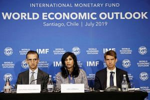 Gita Gopinath, Economic Counsellor and Director of the Research Department at the International Monetary Fund (IMF), next to Gian Maria Milesi-Ferretti, Deputy Director of Research Department of the IMF, speaks during a news conference in Santiago, C