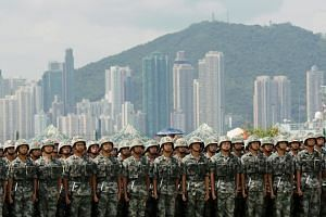 People's Liberation Army soldiers at an open day at Stonecutters Island naval base in Hong Kong on June 30, 2019.