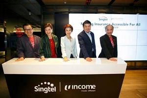 (From left) Mr Arthur Lang, CEO of International at Singtel, Ms Chua Sock Koong, Group CEO of Singtel, Ms Low Yen Ling, Senior Parliamentary Secretary for Manpower, Mr Andrew Yeo, CEO of NTUC Income, and Mr Yuen Kuan Moon, CEO of Consumer Singapore a