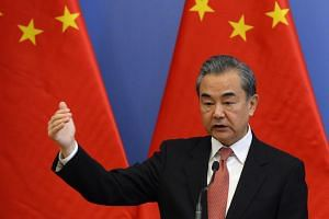 Chinese Foreign Minister Wang Yi will meet his counterparts at the the Asean Foreign Ministers' Meeting in Bangkok to discuss promoting regional cooperation in East Asia.