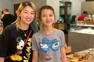 Ms Connie Ng (right) is currently learning to take over her family's bakery chain, Bread Story, together with her sister, Jessie.