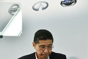 Nissan Motors president and CEO Hiroto Saikawa leaves a press conference after announcing that net profit plunged in the first quarter due to slumping sales and growing costs.