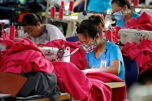 Women working at a garment factory in Thai Binh province, Vietnam. Labour costs in countries like Vietnam, India and Bangladesh are a fraction of that in the US. PHOTO: REUTERS
