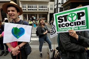 Climate activists hold a protest outside the Royal Courts of Justice in London, Britain, on July 15, 2019.