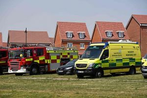 Fire trucks and emergency response vehicles are parked outside a house in Britain following the Novichok poisonings.