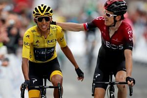 Team Ineos rider Egan Bernal of Colombia celebrates as he finishes with team mate Geraint Thomas of Britain.