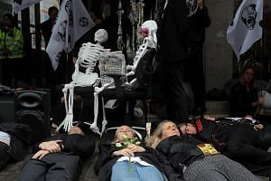 """Climate activists from Extinction Rebellion staging a """"die-in"""" protest outside Northcliffe House in London on July 19."""