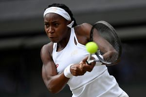 Gauff in action during her fourth-round Wimbledon match against Romania's Simona Halep.
