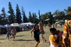 People running after reports of an active shooter at the Gilroy Garlic Festival near San Jose, California, on July 28, 2019.