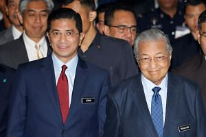 Malaysia's Economic Affairs Minister Azmin Ali and Prime Minister Mahathir Mohamad at the opening ceremony of the 20th Asia Oil & Gas Conference in Kuala Lumpur on June 24, 2019.