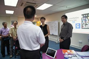 Manpower Minister Josephine Teo and chief executive of ComfortDelGro's taxi business Ang Wei Neng visiting the SkillsFuture for Digital Workplace Class at ComfortDelGro Taxi's CityCab building in Sin Ming Avenue on July 29, 2019.