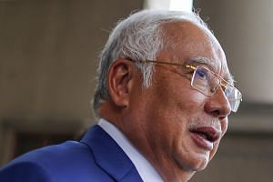 Lawyers for Malaysian leader Najib Razak, who has pleaded not guilty, argued that he was misled by others, including a former CEO of SRC who is at large.