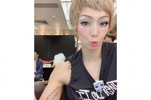 Sammi Cheng poses for a selfie backstage before the third show of her FollowMi Sammi Cheng World Tour on July 14, 2019. Her selfie shows husband Andy Hui, who was caught in a cheating scandal in April, in the background.