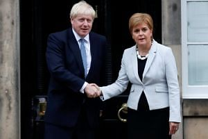 Britain's Prime Minister Boris Johnson shakes hands with Scotland's First Minister Nicola Sturgeon at Bute House in Edinburgh, Scotland, on July 29, 2019.