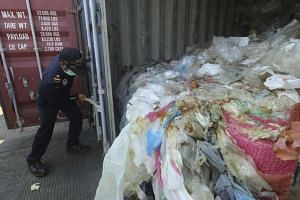 According to customs officials on Batam, the containers were loaded with a combination of garbage, plastic waste and hazardous materials in violation of import rules.