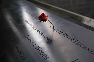 A rose is placed along a victim's name at the National September 11 Memorial & Museum, on July 23, 2019 in New York City.