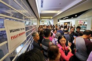 Members of the public seen outside the Huawei store at Nex shopping mall in Serangoon on July 26, 2019. Many consumers who queued up for the Huawei Y6 Pro were disappointed and angry.