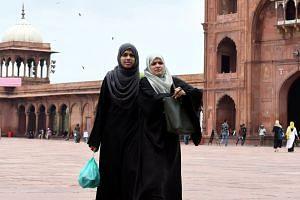 Indian Muslim women visiting the Jama Masjid in New Delhi.