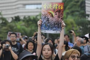 Protesters gather before a march to the West Kowloon railway station in Hong Kong on July 7, 2019. The study found that Hong Kong residents rated their happiness levels at an average of 6.80 on a scale of 1 to 10, compared with 7.48 for Singaporeans.