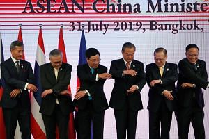 From far left: Singapore's Foreign Minister Vivian Balakrishnan, Thailand's Minister of Foreign Affairs Don Pramudwinai, Vietnam's Foreign Minister Pham Binh Minh, China's Foreign Minister Wang Yi, Philippine Secretary of Foreign Affairs Teodoro Locs
