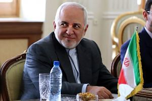 Zarif attends a meeting with Oman's Minister of State for Foreign Affairs Yousuf bin Alawi bin Abdullah in Teheran.