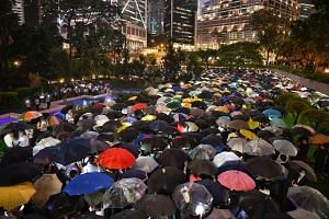 """Chater Garden was turned into a sea of umbrellas as finance sector professionals carried out a """"flash mob"""" at 7.15pm on Aug 1, 2019."""