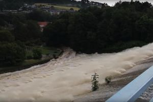 Footage posted on social media showed water gushing from the Toddbrook Reservoir which sits above Whaley Bridge in Derbyshire, central England.