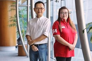 Mr Willson Tang and Ms Eileen Chua were among some 52 civilians who received awards during the Home Team National Day Observance Ceremony at New Phoenix Park.