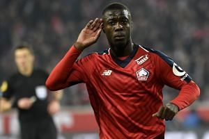 Ivorian forward Nicolas Pepe celebrates a goal for Lille.