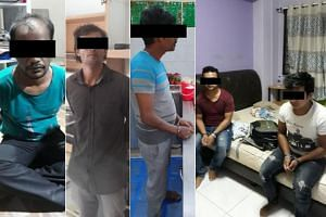 Some of the 21 suspects arrested for immigration-related offences during an operation across Singapore between July 29, 2019, and Aug 1, 2019.