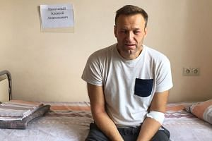 Navalny sitting on a hospital bed in Moscow in a photo posted to his official website.