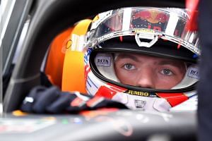 Red Bull's Verstappen waits in his car before the second practice session of the Hungarian grand prix.