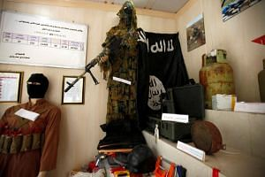 An Islamic State flag and items which were used by Islamic state militants are seen at a museum opened by the Engineering Unit of Peshmerga forces in Erbil, Iraq, on May 12, 2019.