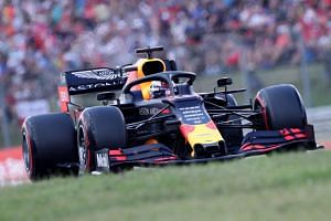 Max Verstappen secured his first pole position in style with a record lap at the Hungaroring.