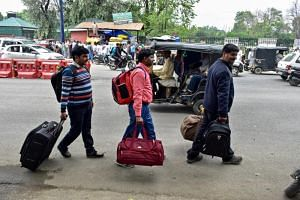 People arriving at a general bus station to leave Kashmir on Aug 3, 2019.